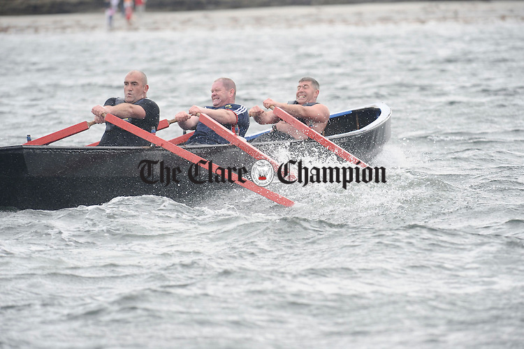 Mike Grimes, Robert Kenny and Tom Davis of Coonagh battle it out at the Leon Currach Regatta at Seafield, Quilty. Photograph by John Kelly.