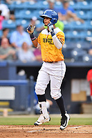 Beer City Tourists center fielder Manny Melendez (19) celebrates as he crosses home plate during a game against the Lakewood BlueClaws at McCormick Field on June 1, 2017 in Asheville, North Carolina. The Tourists defeated the BlueClaws 8-5. (Tony Farlow/Four Seam Images)