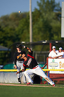 Batavia Muckdogs first baseman Angel Reyes (30) attempts to catch a popup during a game against the West Virginia Black Bears on August 30, 2015 at Dwyer Stadium in Batavia, New York.  Batavia defeated West Virginia 8-5.  (Mike Janes/Four Seam Images)