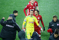 Pictured: Silvio Proto (C) and other Olympiacos players walk off the pitch at Toumba Stadium in Thessaloniki, Greece. Sunday 25 February 2018<br /> Re: Sunday's Greek Super League derby between PAOK Thessaloniki and Olympiakos was called off after Olympiakos' manager Oscar Garcia was struck in the face by an object believed to be a till machine paper roll, thrown by a spectator minutes before kick-off.<br /> Garcia left Toumba Stadium for a local hospital to seek treatment for a bloodied lip.<br /> The incident prompted the Olympiakos team to leave the pitch in protest before riots erupted outside the ground.<br /> Angry PAOK fans leaving the stadium then clashed with police who used tear gas to quell the violence.