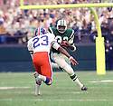 New York Jets Emerson Boozer (32) running against Denver Broncos Drake Garrett (23) during a game on October 13, 1968 at Shea Stadium in Flushing, New York.  The Denver Broncos beat the New York Jets 721-13. Emerson Boozer played for 10 season all with the Jets and was a 2-time Pro Bowler(SportPics)