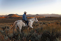 Edgar Oscanoa rides Dot, the former mustang, trails sheep in Upper Gully with the help of border collies and guard dogs. He lives at a camp and works alone at the Ladder Livestock Ranch in southern Wyoming (west of Bags at the Colorado border.) <br />