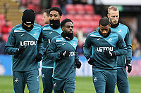 (L-R) Oliver McBurnie, Leroy Fer, Nathan Dyer, Luciano Narsingh and Mike van der Hoorn of Swansea City warm up prior to the game during the Premier League match between Watford and Swansea City at the Vicarage Road, Watford, England, UK. Saturday 30 December 2017