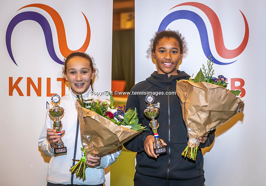 Wateringen, The Netherlands, December 15,  2019, De Rhijenhof , NOJK juniors doubles , Final girls12 years, runners up Silver Bijlsma(NED)  and Megan Caffin (NED) (R) with the trophy<br /> Photo: www.tennisimages.com/Henk Koster