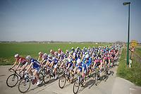 peloton crossing the superflat De Moeren<br /> <br /> Gent-Wevelgem 2014