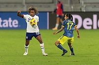 ORLANDO, FL - JANUARY 22: Catarina Macario #29 settles the ball off her chest while defended by Carolina Arias #17 during a game between Colombia and USWNT at Exploria stadium on January 22, 2021 in Orlando, Florida.