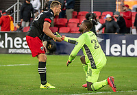 WASHINGTON, DC - MARCH 07: Frédéric Brillant #13 of DC United with Bill Hamid #24 at the end of the match during a game between Inter Miami CF and D.C. United at Audi Field on March 07, 2020 in Washington, DC.