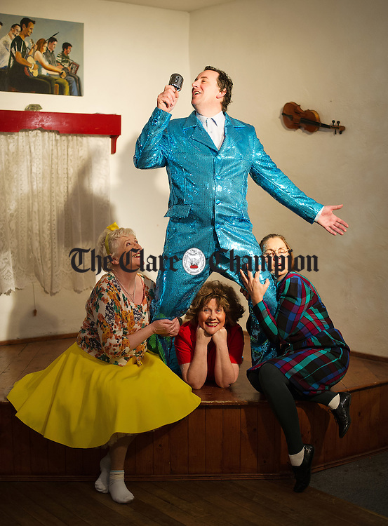 """Geraldine Greene, as Clara, Eileen Lahiffe as Breda and Maura Clancy as Ada get up close and personal with Martin O Donoghue as Patsy in rehearsals for Corofin Dramatic Society's production of the """"The New Electric Ballroom""""  by Enda Walsh. Photograph by John Kelly."""