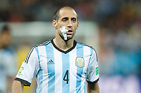 Pablo Zabaleta of Argentina with plasters to protect his face injury