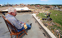 """""""There ain't nothing here in this house,"""" said Walt Truitt as he sits on a bare slab that used to be the house of his duagther, Paula Buchholz Monday, May 26, 2008 in Parkersburg, Iowa. """"It didn't take two minutes to wipe it all away;"""" he said of Sunday night's EF-5 tornado.  Truitt survived the tornado with his family in the house's basement."""