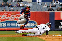 Apr 07, 2011; Bronx, NY, USA; Minnesota Twins infielder Tsuyoshi Nishioka (1) is injured by New York Yankees runner Nick Swisher (33) while trying to complete a double play at Yankee Stadium. Yankees defeated the Twins 4-3. Mandatory Credit: Tomasso De Rosa/ Four Seam Images