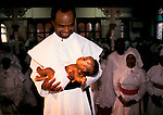 Christening new born child 1990s UK. Baby Naming Ceremony at the church of the Brotherhood of the Cross and Star London.1990s<br /> from A STORM IS PASSING OVER a Look at Black Churches in Britain. Published by Thames and Hudson isbn 0 500 27826 1