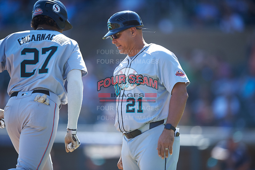 Salt River Rafters Jerar Encarnacion (27), of the Miami Marlins organization, is congratulated by manager Keith Johnson (21) after hitting a grand slam during the Arizona Fall League Championship Game against the Surprise Saguaros on October 26, 2019 at Salt River Fields at Talking Stick in Scottsdale, Arizona. The Rafters defeated the Saguaros 5-1. (Zachary Lucy/Four Seam Images)