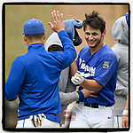 Right fielder Dosi Jonas (15) of the Spartanburg Methodist College Pioneers is greeted after hitting a home run in Game 2 of a junior college doubleheader against the Southeastern Community Rams on Tuesday, March 26, 2019, at Mooneyham Field in Spartanburg, South Carolina. SMC won, 4-3. (Tom Priddy/Four Seam Images)