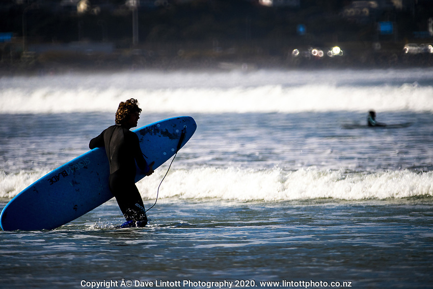 Surfing at Lyall Bay during Level 3 lockdown for the COVID-19 pandemic in Wellington, New Zealand on Sunday, 10 May 2020. Photo: Dave Lintott / lintottphoto.co.nz