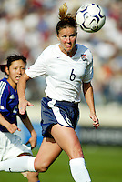 Brandi Chastain heads the ball during a 0-0 tie in San Diego, Calif.,  January 12, 2003.