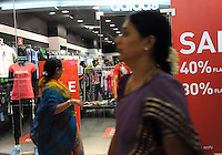 Sale signs in front of sports wear shop in a  big modern shopping mall in Madras, India