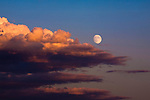 Clouds and full moon at sunset