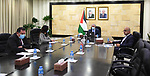 Palestinian Prime Minister Mohammad Ishtayeh, speaks during a meeting with the Palestinian community in the United States of America, via a video link in the West Bank city of Ramallah, on February 28, 2021. Photo by Prime Minister Office
