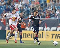 New England Revolution defender AJ Soares (5) passes the ball. In a Major League Soccer (MLS) match, New England Revolution defeated New York Red Bulls, 2-0, at Gillette Stadium on July 8, 2012.
