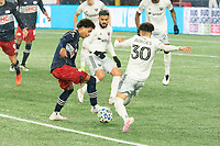 FOXBOROUGH, MA - NOVEMBER 1: Tajon Buchanan #17 of New England Revolution dribbles the ball as Kevin Paredes #30 of DC United comes in to tackle during a game between D.C. United and New England Revolution at Gillette Stadium on November 1, 2020 in Foxborough, Massachusetts.