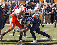 Pitt defensive back Phil Campbell makes a tackle. The Pitt Panthers upset the undefeated Miami Hurricanes 24-14 on November 24, 2017 at Heinz Field, Pittsburgh, Pennsylvania.