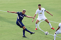 CARY, NC - AUGUST 01: Robert Kristo #11 takes a shot past Alex Crognale #21 during a game between Birmingham Legion FC and North Carolina FC at Sahlen's Stadium at WakeMed Soccer Park on August 01, 2020 in Cary, North Carolina.