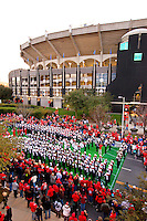 The North Carolina State marching band performs for the crowds during the 2011 Belk Bowl pregame festivities outside Bank of America in Charlotte, North Carolina...Photo by: Patrick SchneiderPhoto.com
