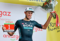 8th July 2021; Nimes, France; POLITT Nils (GER) of BORA - HANSGROHE pictured with the Antargaz price during the podium ceremony  during stage 12 of the 108th edition of the 2021 Tour de France cycling race, a stage of 159,4 kms between Saint-Paul-Trois-Chateaux and Nimes.