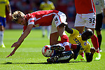 Barnsley v Crawley Town<br /> 9.8.2014<br /> Sky Bet League One<br /> Picture Shaun Flannery/Trevor Smith Photography<br /> Crawley's Connor Henderson challenges Barnsley's Luke Berry.