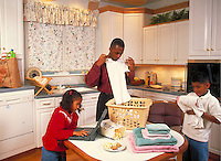 African-american father and children in kitchen