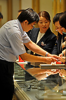 A Chinese tourist buys duty free gold in the upmarket Ginza area of Central Tokyo, 17th September, 2008.<br /><br />PHOTO BY RICHARD JONES / SINOPIX