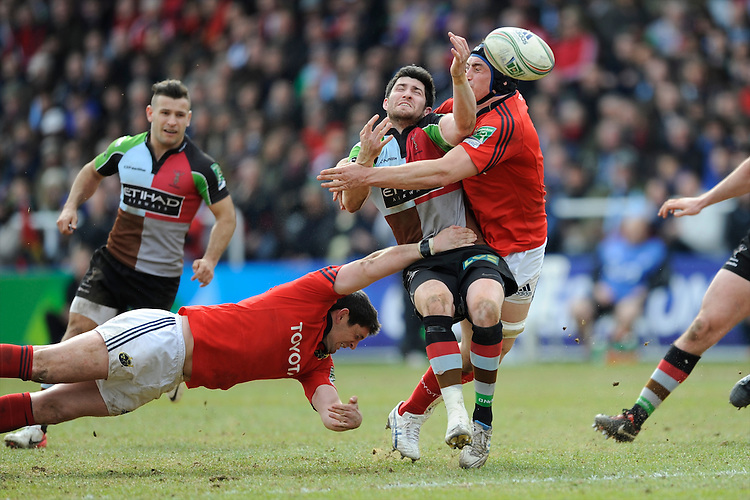 Tom Casson of Harlequins loses the ball as he tackled by Tommy O'Donnell of Munster Rugby during the Heineken Cup quarter final match between Harlequins and Munster at the Twickenham Stoop on Sunday 7th April 2013 (Photo by Rob Munro)