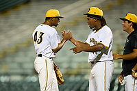 Bradenton Marauders pitcher Oliver Mateo (43) celebrates with Luis Ortiz (41) after closing out Game Two of the Low-A Southeast Championship Series against the Tampa Tarpons on September 22, 2021 at LECOM Park in Bradenton, Florida.  (Mike Janes/Four Seam Images)