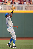 UCLA outfielder Brenton Allen (23) makes a catch during Game 1 of the 2013 Men's College World Series Finals against the Mississippi State Bulldogs on June 24, 2013 at TD Ameritrade Park in Omaha, Nebraska. The Bruins defeated the Bulldogs 3-1, taking a 1-0 lead in the best of 3 series. (Andrew Woolley/Four Seam Images)