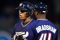 Salvador Perez (39) of the Northwest Arkansas Naturals talks with Hitting Coach Terry Bradshaw (41) during a game against the San Antonio Missions at Arvest Ballpark on June 30, 2011 in Springdale, Arkansas. (David Welker / Four Seam Images)