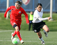 Rebecca Moros #19 of the Washington Freedom moves away from Karina Maruyama #11 of the Philadelphia Independence during a WPS pre season match at the Maryland Soccerplex on March 27 2010 in Boyds, Maryland. The game ended in a 0-0 tie.