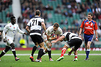 Jon Fisher of England is stopped by Pablo Matera and Ruan Pienaar of Barbarians during the match between England and Barbarians at Twickenham Stadium on Sunday 31st May 2015 (Photo by Rob Munro)