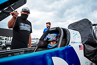 Jul 11, 2020; Clermont, Indiana, USA; NASSCAR hall of fame driver Tony Stewart (left) stands alongside the dragster of NHRA top fuel driver Leah Pruett during qualifying for the E3 Spark Plugs Nationals at Lucas Oil Raceway. This is the first race back for NHRA since the start of the COVID-19 global pandemic. Mandatory Credit: Mark J. Rebilas-USA TODAY Sports