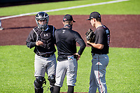 South Carolina Gamecocks catcher Colin Burgess (left) joins a meeting on the mound with assistant coach Skylar Meade and pitcher Brett Kerry versus the Vanderbilt Commodores at Hawkins Field in Nashville, Tennessee, on March 21, 2021. The Gamecocks won 6-5. (Danny Parker/Four Seam Images)
