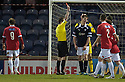 Raith's Dougie Hill is sent off by Referee Paul Robertson after he brings down Deveronvale's Kris Duncan in the penalty area ...