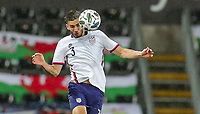 SWANSEA, WALES - NOVEMBER 12: Matt Miazga #3 of the United States heads a ball during a game between Wales and USMNT at Liberty Stadium on November 12, 2020 in Swansea, Wales.