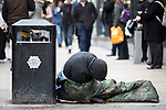 © Joel Goodman - 07973 332324 . 06/04/2017 . Manchester , UK . A man lies half slouched over and static in front of a branch of Morrisons Supermarket , on Piccadilly in Manchester . An epidemic of abuse of the drug spice by some of Manchester's homeless population , in plain sight , is causing users to experience psychosis and a zombie-like state and is daily being witnessed in the Piccadilly Gardens area of Manchester , drawing large resource from paramedic services in the city centre . Photo credit : Joel Goodman