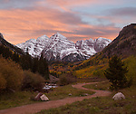 Snow on the Maroon Bells in autumn, west of Aspen, Colorado. John offers fall foliage photo tours throughout Colorado.