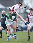 Kealan Guyler of  Ennistymon CBS  in action against Aidan Behan of  St Declan's Kilmacthomas during their Munster C Colleges football final at Rathkeale. Photograph by John Kelly.