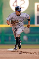 12 June 2006: Jamey Carroll, infielder for the Colorado Rockies, hustles to third during a game against the Washington Nationals at RFK Stadium, in Washington, DC. The Rockies defeated the Nationals 4-3 in the first game of the four game series...Mandatory Photo Credit: Ed Wolfstein Photo..