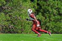 Jul 31, 2009; Flagstaff, AZ, USA; Arizona Cardinals wide receiver Larry Fitzgerald runs a route during training camp on the campus of Northern Arizona University. Mandatory Credit: Mark J. Rebilas-