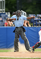 Umpire Edwin Moscoso makes a call during the second game of a doubleheader between the Connecticut Tigers and Batavia Muckdogs on July 20, 2014 at Dwyer Stadium in Batavia, New York.  Connecticut defeated Batavia 2-0.  (Mike Janes/Four Seam Images)