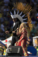 Shakira and Carlinhos Brown perform during the closing ceremony