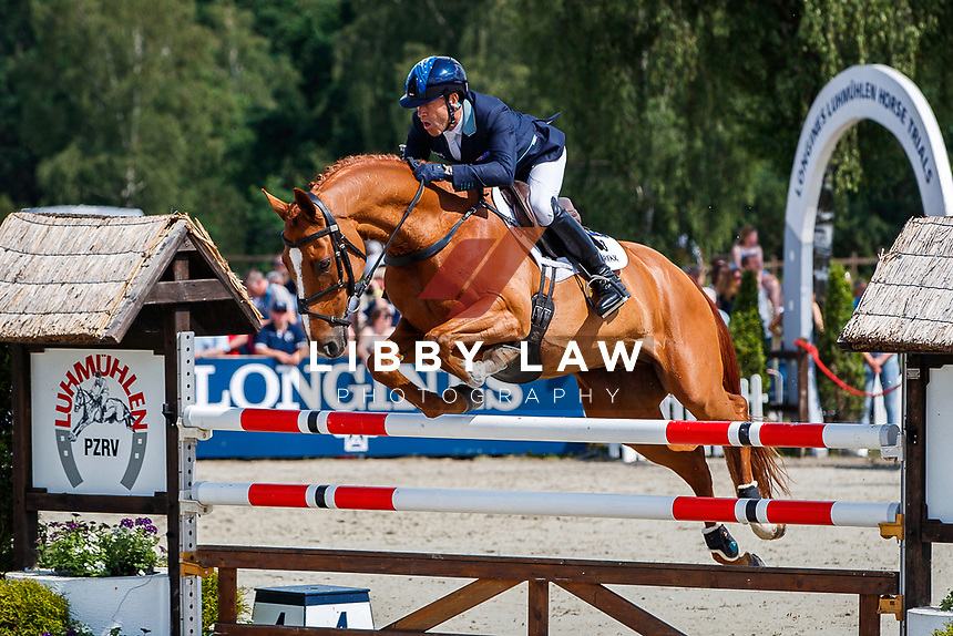 AUS-Andrew Hoy rides Vassily de Lassos during the Showjumping for the Meßmer Trophy mit Deutscher Meisterschaft CCI4*-S. Final-5th. The Longines Luhmuehlen International Horse Trials. Salzhausen, Germany. Sunday 16 June. Copyright Photo: Libby Law Photography